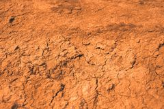 The surface of the cracked dried clay background stock photos
