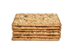 Brown crackers topped with seeds Royalty Free Stock Photo