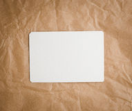 Brown craft paper with a blank tag Royalty Free Stock Images