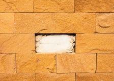 Brown creak brick stone wall Stock Image