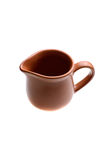 Brown creamer on the white Royalty Free Stock Photography