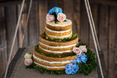 Brown and creamy white wedding cake Stock Photos