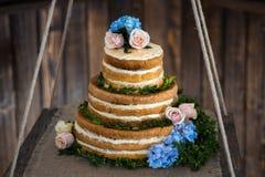 Brown and creamy white wedding cake Stock Photos