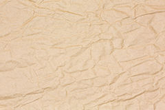 Brown crinkled paper. Crinkled brown recycled paper background Stock Image