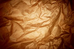 Brown crisped paped background. With spotlight in the center and dark edges stock photos