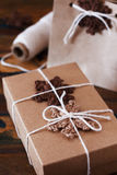 Brown crochet snowflakes for Christmas decoration of gift box an Stock Photos