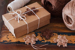 Brown crochet snowflakes for Christmas decoration of gift box Stock Photos