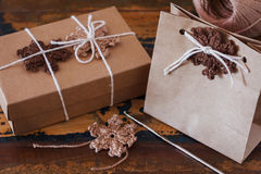 Brown crochet snowflakes for Christmas decoration of package and Stock Photo