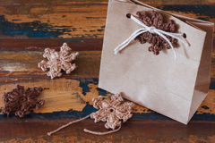 Brown crochet snowflakes for Christmas decoration of paper gift Stock Photography