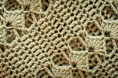 A brown crochet texture, blanket. A horizontal or vertical of a brown crochet texture, blanket royalty free stock images