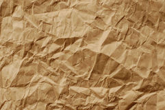 Brown crumpled paper. The image of brown crumpled paper stock photography