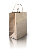 Brown Crumpled paper bag. On reflect floor Stock Image