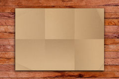 Brown Crumpled paper on wood Stock Image
