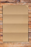 Brown Crumpled paper on wood Royalty Free Stock Image