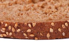 Brown crust of bread sprinkled with sesame seeds  Stock Photo
