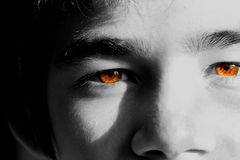 Brown Crystal Clear Eyes. Close up of brown crystal clear eyes of a young boy on black and white. Fit for power, futuristic, fiction, fictive, etc. concept royalty free stock photo