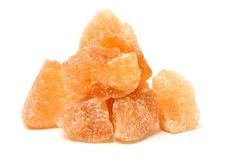 Brown crystal sugar. On white background Royalty Free Stock Images