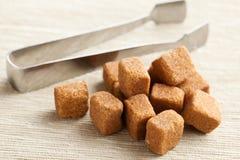 Brown cubes of sugar Stock Photos