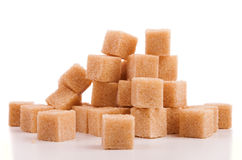 Brown cubes of sugar Royalty Free Stock Photos