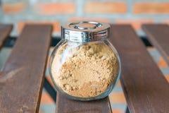 Brown cukier w szklanej butelce Zdjęcie Stock