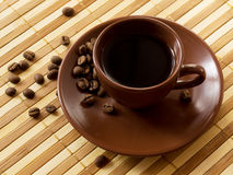 Brown cup of coffee royalty free stock photography