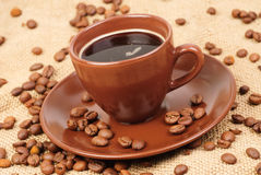 Brown cup of coffee Stock Photos