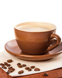 Brown cup of coffee on the table Stock Images