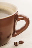 Brown cup of coffee on the table Stock Image