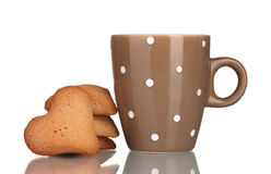Brown cup and heart-shaped cookies Stock Image