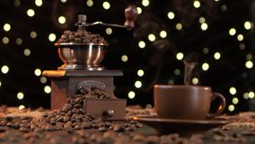 Brown cup hot drink with smoke and coffee grinder. Studio stock footage