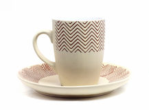 Brown cup on a plate Royalty Free Stock Images