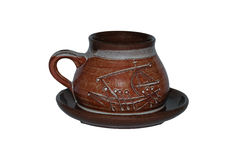 Brown cup with saucer Stock Images