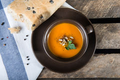 Brown cup with squash soup Royalty Free Stock Photography