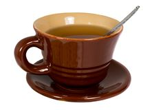 Brown cup of tea Stock Images