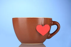 Brown cup and tea bag Royalty Free Stock Photo