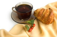 Brown cup of tea and croissants Stock Image
