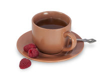 Brown cup of tea with raspberry Stock Images