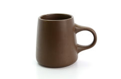 Brown cup on a white background Royalty Free Stock Image