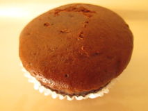 Brown Cupcake. A single undecorated brown cupcake Royalty Free Stock Image