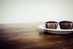 Brown Cupcake on White Ceramic Plate Royalty Free Stock Images