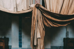 Brown Curtain Near Brown Wooden Table and Black Steel Candle Holder Royalty Free Stock Photo