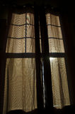 Brown curtain with sunlight shining through silhouette of window Stock Photography