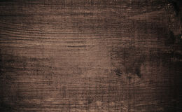 Brown dark scratched wooden cutting, chopping board. Wood texture. Royalty Free Stock Image