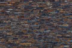 Brown, dark Slate Stone Wall Background. Royalty Free Stock Photography
