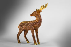 Brown decoration deer with golden horn Royalty Free Stock Image