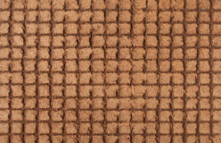 Brown decorative plaster on the basis of the small square of pla Royalty Free Stock Photo