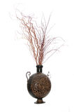 Brown decorative vase. Composition of brown decorative vase filled with red artificial branches Royalty Free Stock Photos