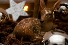 Brown Deer Figurine and White Star Decor Royalty Free Stock Images
