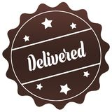Brown DELIVERED stamp on white background. Royalty Free Stock Photo