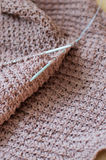 Brown detail of woven handicraft knit sweater Stock Images